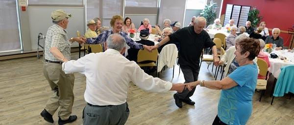 """Holocaust victims dance at the """"Reaching Out"""" socialization program of Jewish Child and Family Service of Winnipeg, Canada which is supported by a Claims Conference grant."""
